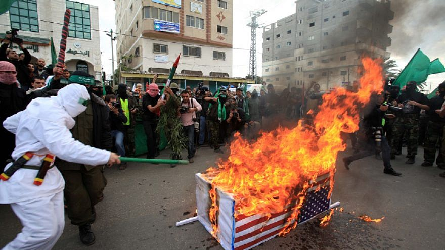 Palestinian Hamas militants set fire to a coffin wrapped with U.S. flag during an anti-Israeli rally in al-Nuseirat refugee camp in the center of the Gaza Strip on Dec. 11, 2009. Photo by Wissam Nassar/Flash90.