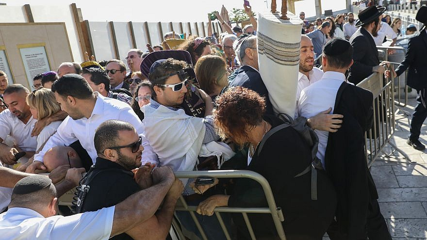 Members of the Reform movement and Hebrew Union College confront police and security guards while trying to enter a mixed men and women prayer area at the public square in front of the Western Wall in Jerusalem's Old City on Nov. 16, 2017.