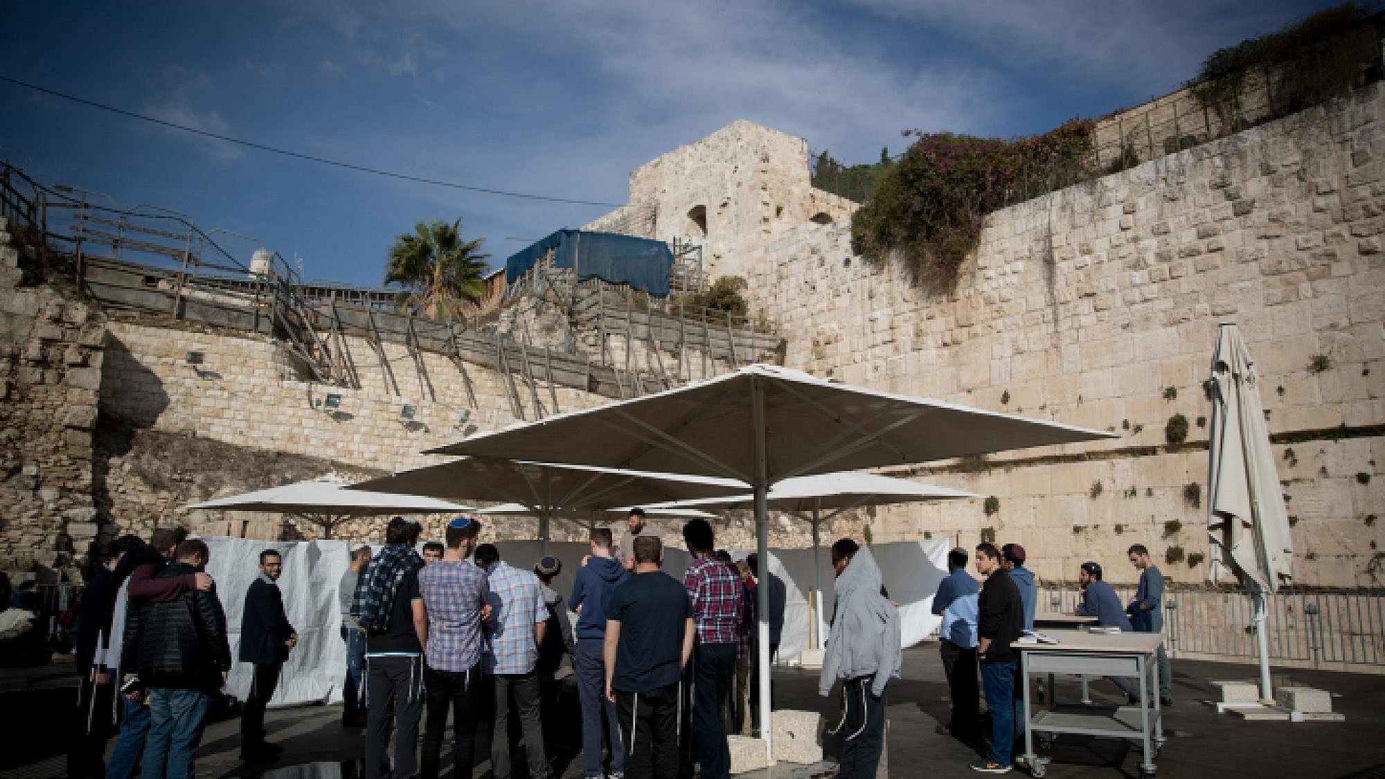 Jews pray at the mixed-gender prayer section at the Western Wall in Jerusalem's Old City on Jan. 3, 2018. Photo by Yonatan Sindel/Flash90.