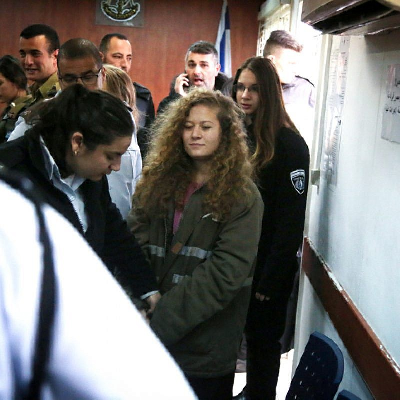 Seventeen-year-old Palestinian Ahed Tamimi, a well-known Palestinian campaigner against Israel's occupation, arrives for the beginning of her trial in the Israeli military court at Ofer military prison in the West Bank village of Betunia on February 13, 2018. The Israeli military trial of a Palestinian teenager charged after a viral video showed her hitting two soldiers behind closed doors. The judge in the trial ordered journalists removed from the courtroom, ruling that open proceedings would not be in the interest of 17-year-old Ahed Tamimi, who is being tried as a minor. Photo by Flash90.