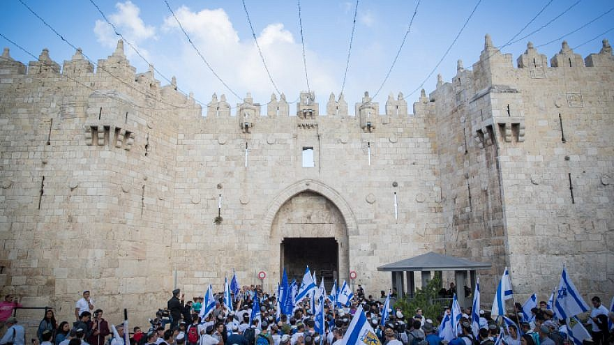 "Thousands wave Israeli flags as they celebrate ""Jerusalem Day"" by dancing through Damascus Gate on their way to the Western Wall. May 13, 2018. Photo by Yonatan Sindel/Flash90."