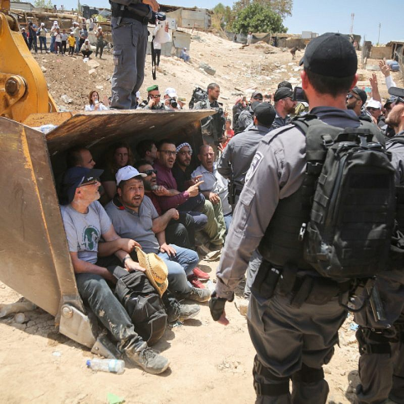 Israeli police scuffle with Palestinian demonstrators in the Bedouin village of al-Khan al-Ahmar, east of Jerusalem, on July 4, 2018. Photo by Flash90.