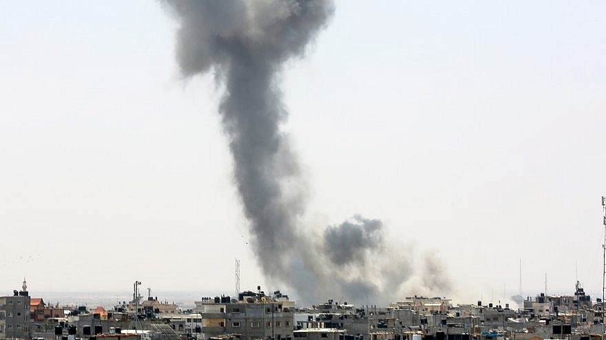 Smoke rises from a location reportedly belonging to Hamas after an Israeli airstrike in the southern Gaza town of Rafah on July 14, 2018. Photo by Abed Rahim Khatib/Flash90.