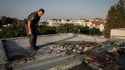View of the damage caused by a rocket that hit a rooftop of a building in the southern Israeli city of Sderot, during an escallation in rocket fire in the Gaza envelope Israeli towns, on July 14, 2018. Photo by Hadas Parush/Flash90