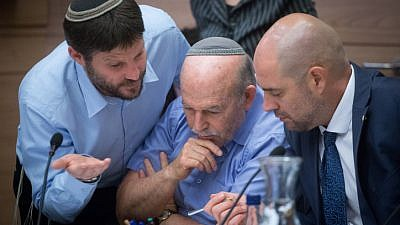 Committee chairman Amir Ohana (right) with Jewish Home parliament members Nissam Slomiansky (center) and Bezalel Smotrich at the joint Knesset and Constitution Committee meeting discussing the proposed National Law at the Knesset, July 16, 2018. Photo by Miriam Alster/Flash90.