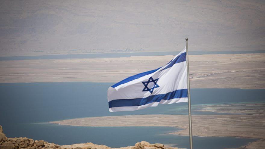 An Israeli flag on Masada, near the Dead Sea in southern Israel, on July 19, 2018. Photo by Yonatan Sindel/Flash90.