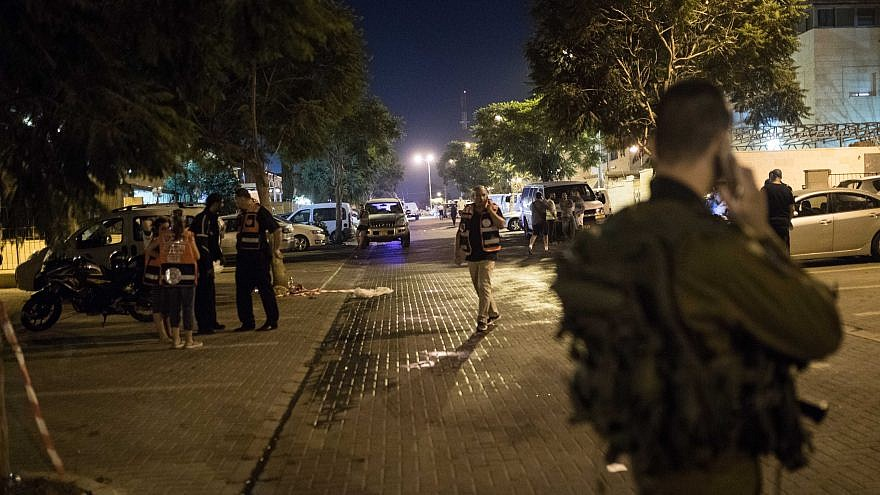 Israeli security forces at the scene of a stabbing attack in the Jewish settlement of Adam north of Jerusalem