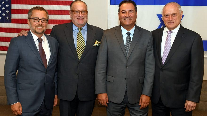 At Israel Bonds headquarters in New York are (from left) Arthur Stark, chairman of the Conference of Presidents of Major American Jewish Organizations; Howard Goldstein, board chairman of Israel Bonds; Israel Maimon, president and CEO of Israel Bonds; and longtime Conference of Presidents CEO Malcolm Hoenlein. Photo by Shahar Azran.