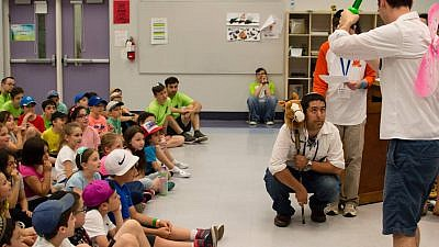 Children watch camp counselors perform at Camp Moshava in Toronto, Canada. Credit: Ariel Marcus.