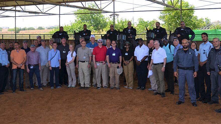 The delegation of 21 senior law-enforcement officials from Georgia, Alabama and Tennessee with the Tel Aviv Mounted Police. Credit: Georgia International Law Enforcement Exchange (GILEE).