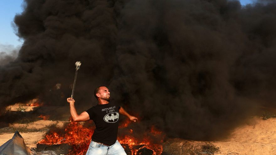 File photo: Palestinian protesters launch incendiary devices on the Gaza border with Israel on July 20, 2018. Photo by Abed Rahim Khatib/Flash90.