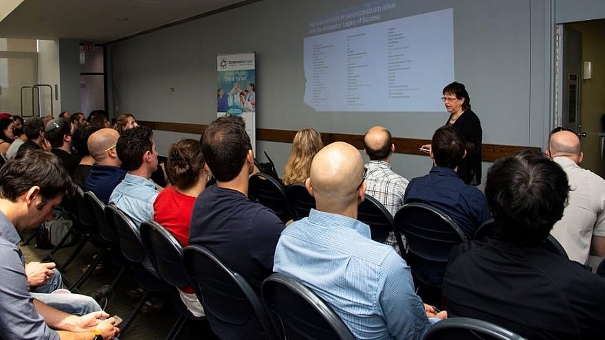 Professor Shulamit Michaeli, vice president for research at Bar-Ilan University, addresses Israeli researchers living in the United States who were pre-selected to interview for STEM-related faculty positions back in Israel. Credit: Magali Druscovich.