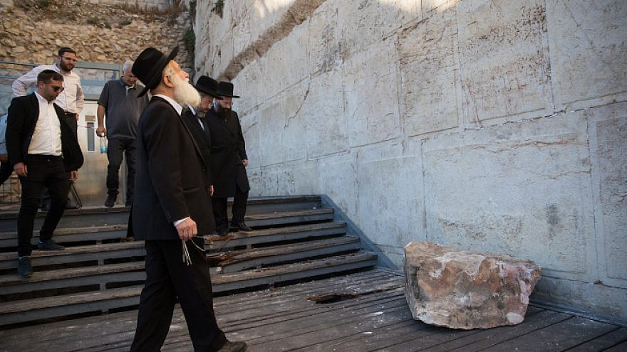 220-pound stone falls out of the Western Wall, narrowly