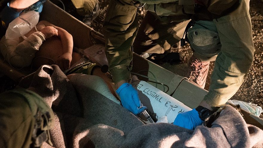 Israel Defense Forces soldiers providing emergency medical care to young Syrians injured in attacks by Syrian President Bashar Assad on rebel-held towns near Daraa, prior to evacuating them to Israel. Source: IDF Spokesperson's Unit.