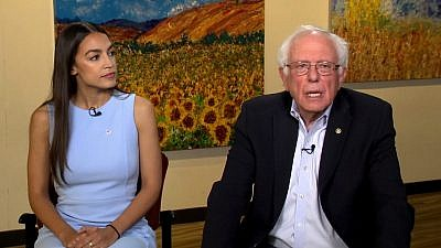 "Then-Congresswoman-elect from New York Alexandria Ocasio-Cortez with Sen. Bernie Sanders (I-Vt.) on CBS's ""Face the Nation."" Source: Screenshot."
