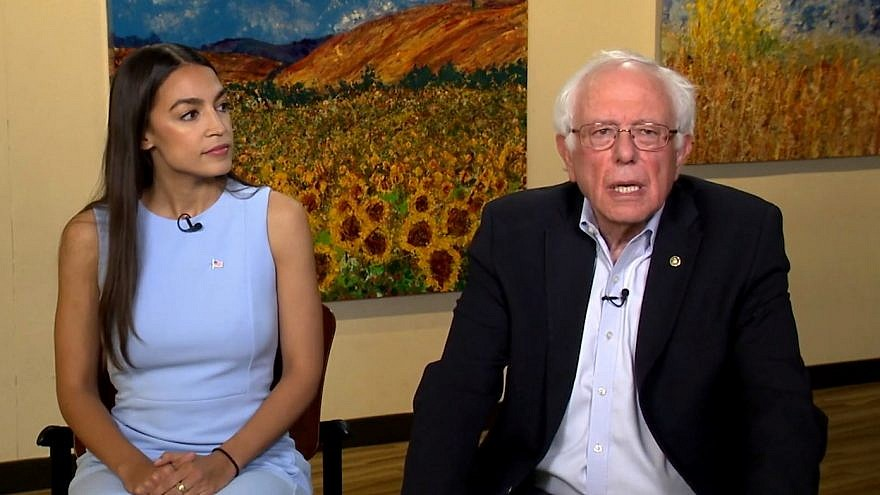 """Democratic candidate for Congress from New York Alexandria Ocasio-Cortez with Sen. Bernie Sanders (I-Vt.) on CBS's """"Face the Nation."""" Credit: Screenshot."""