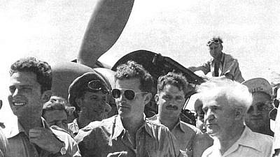 "Former Israeli Prime Minister David Ben-Gurion (right) visits the ""Machal 101"" air squadron. Pilot Gideon Lichtman is pictured at the far left. Credit: Wikimedia Commons."