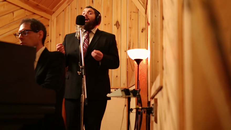 """With jazz backup, Cantor Aryeh Leib Hurwitz sings """"Sheyibone,"""" a fundamental Jewish prayer beseeching G-d to rebuild the Beit Hamikdash (Holy Temple), ushering in a period of global unity and harmony. Credit: Courtesy."""