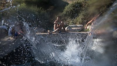 Young Israelis enjoy the cool waters of the Ein Aya spring in the Golan Heights on July 29, 2018. Photo by Hadas Parush/Flash90.