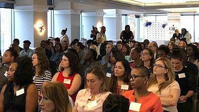 "Some 200 young professionals gathered in Philadelphia on July 31 for the ""Honoring Lauren Simmons, the Lone Woman on Wall Street: Empowering Minorities"" event on  July 31, 2018. Credit: Orthodox Jewish Chamber of Commerce."