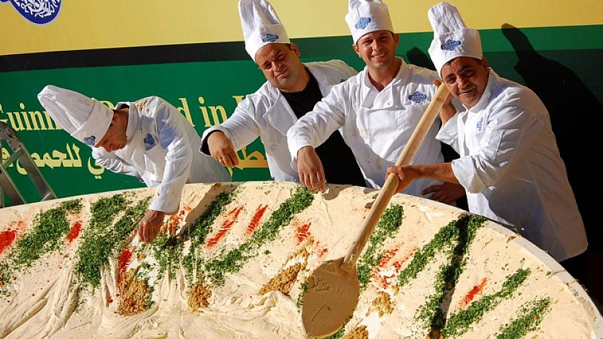 Employees of the Abu Gosh restaurant prepare a 4-ton bowl of hummus with the goal of attaining the Guinness World Record title in 2010. The previous title owner was Lebanon, whose record was 2 tons of hummus.  Photo by Rachael Cerrotti/Flash 90.