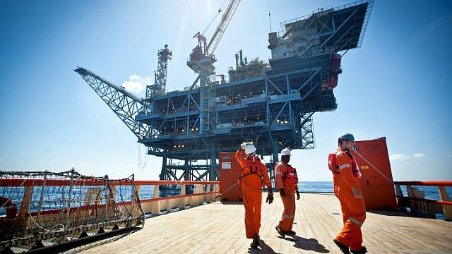 Workers on the Israeli Tamar gas-processing rig some 25 kilometers off the Israeli southern coast of Ashkelon. Noble Energy and Delek are the main partners in the gas field, estimated to contain 10 trillion cubic feet of gas. June 23, 2014. Photo by Moshe Shai/Flash90.