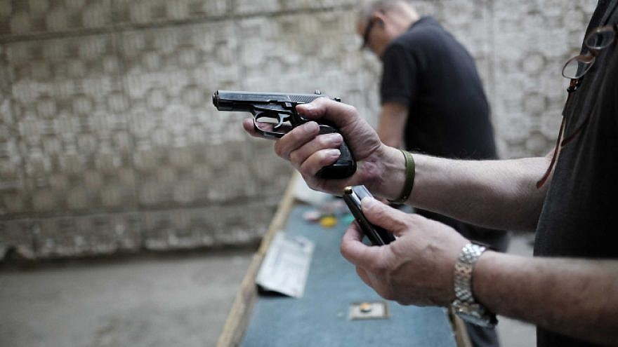 Israelis practice shooting handguns at the Olympic Shooting Range in Herzliya, following a wave of terror attacks in Jerusalem and Israel. Oct. 18, 2015. Photo by Tomer Neuberg/Flash90.