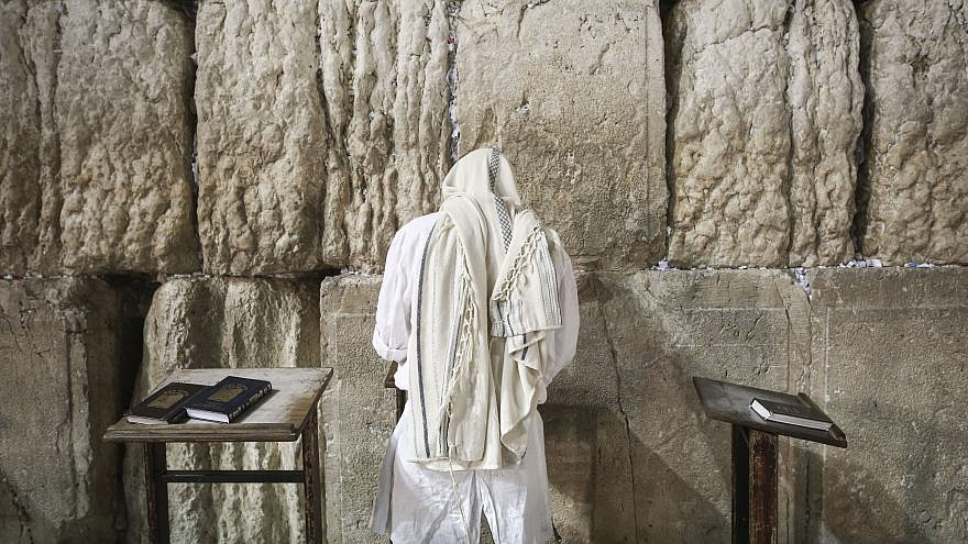 A Jewish worshipper at the Western Wall in the Old City of Jerusalem at the end of Yom Kippur, the Day of Atonement, and the holiest of Jewish holidays. Israel comes to a standstill for 25 hours during the holiday, when Jews traditionally fast and Israelis are prohibited from driving. Photo by Flash90.
