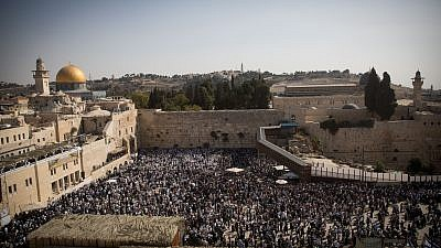 Jewish worshippers pray at the Western Wall in Jerusalem during the Cohen benediction priestly blessing during the holiday of Sukkot, Oct. 8, 2017. Photo by Yonatan Sindel/Flash90.