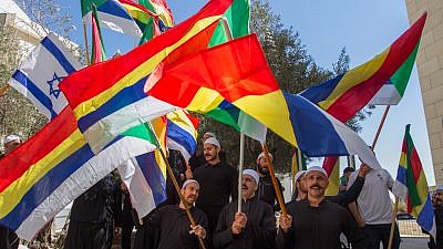 Druze men protest outside the Hafia District Court, carrying both the Druze and the Israeli flags. Photo by Flash90.