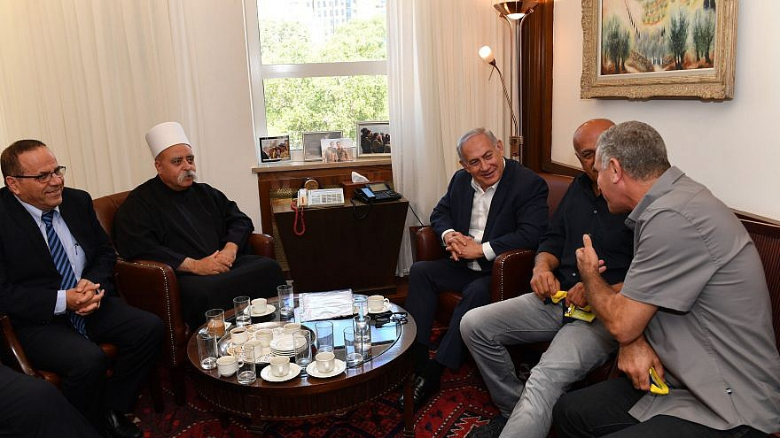 Israeli Prime Minister Benjamin Netanyahu meets with the leader of the Druze community in Israel, Sheikh Mowafaq Tarif (second from left), at the Prime Minister's Office in Jerusalem on July 27, 2018. Photo by Kobi Gideon/GPO.