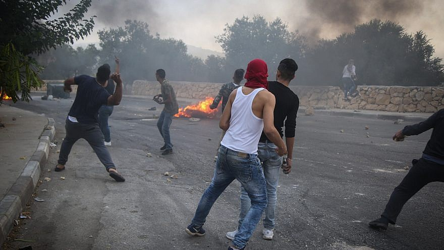Israeli border police clash with Palestinians in the village of Khobar near Ramallah in the West Bank on July 27, 2018. Photo by Flash90.