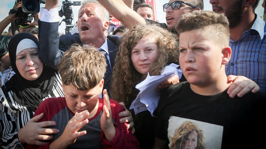 Palestinian teenager Ahed Tamimi is welcomed by relatives and supporters after she was released from prison in Israel on July 29, 2018. Photo by Flash90.