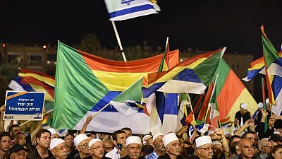 Israeli Druze attend a Druze-led rally to protest against the 'Jewish Nation-State law' in Rabin Square, Tel Aviv on Aug. 04, 2018. Tens of thousands of Israeli Druze and their supporters gathered in Tel Aviv on Saturday night to protest against the 'Jewish Nation-State' law. Photo by Gili Yaari /FLASH90