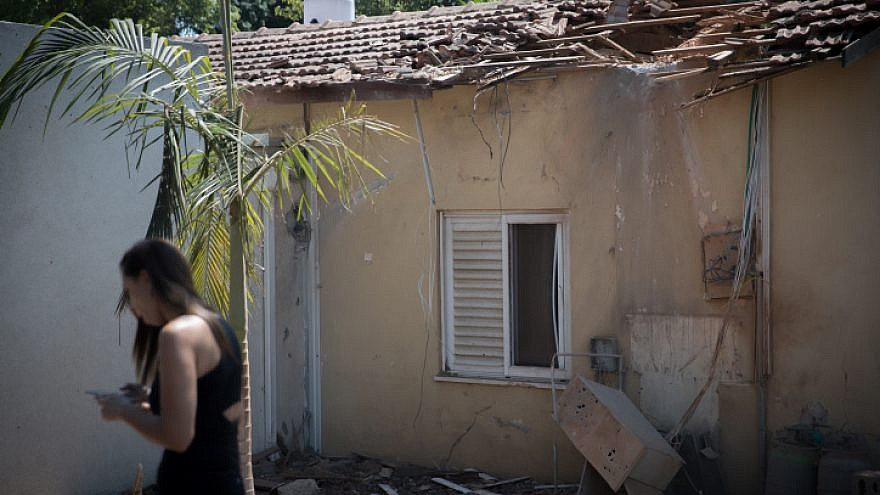 The site where a mortar shell from a Gaza-launched rocket hit a house in southern Israel near the border, on Aug. 9, 2018. Photo by Yonatan Sindel/Flash90.
