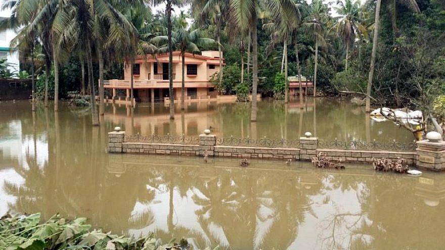A flooded house in Kerala, India, in August 2018. Photo by Santhosh Varghese/Shutterstock.com.