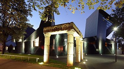 """The new synagogue in Mainz, Germany, inaugurated in 2010 on the site of the elaborate 1922 synagogue destroyed by the Kristallnacht pogroms. The replacement synagogue's sculpted silhouette reads """"kedusha"""" (""""sanctification"""") and bears the name """"Light of the Diaspora,"""" after the nickname of the 11th-century Jewish sage, Rabbi Gershom ben Yehuda, who established Mainz's reputation as a Jewish spiritual center. Credit: Sascha Kopp via Mainz Tourism Office."""