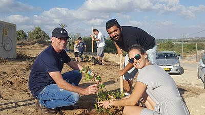 Israelis replant trees after arson attacks from the Gaza Strip in the summer of 2018. Credit: Kibbutz Erez.