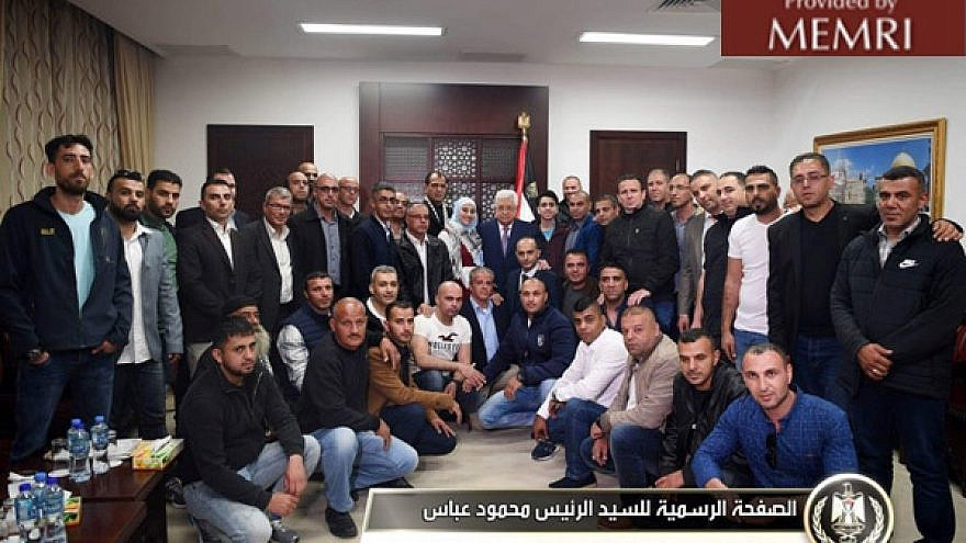 'Abbas, center, meeting with released prisoners who served 15-year sentences in Israeli prisons. Image: Facebook.com/President.Mahmoud.Abbas, April 22, 2018. (MEMRI)