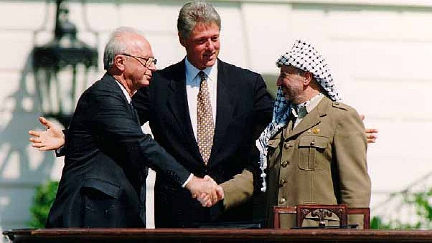 From left: Israeli Prime Minister Yitzhak Rabin, U.S. President Bill Clinton and PLO head Yasser Arafat at the signing of the Oslo Accords on Sept. 13, 1993. Credit: Vince Musi/The White House.