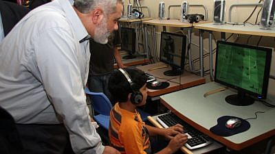 Ismail Haniyeh, who heads the Hamas government in Gaza, visits a computer center for children in Gaza City on Oct. 13, 2008. Photo by Abed Rahim Khatib/Flash 90.