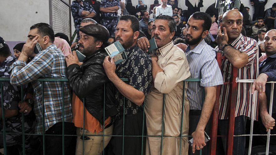 Palestinians wait at the Rafah border crossing with Egypt in the southern Gaza Strip, after it was opened for two days by Egyptian authorities, on May 11, 2016. Photo by Abed Rahim Khatib/Flash90 .