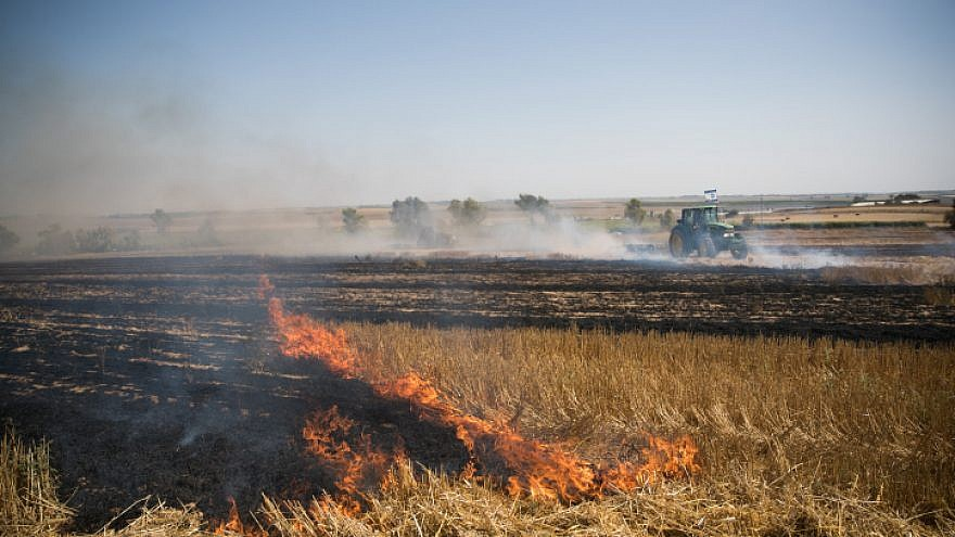 View of a fire at an Israeli wheat field caused from kites flown by Palestinian protesters near the Gaza border on June 5, 2018. Photo by Yonatan Sindel/Flash90.