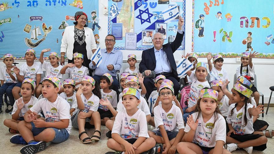 "Israeli President Reuven Rivlin visits students at the religious school ""Noam Eliyahu"" in the southern city of Netivot on the first day of school on Sept. 2, 2018. Photo by Mark Neyman/GPO."