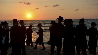 Chassidic men pray on the beach on Sept. 17, 2018 in the southern Israeli city of Ashdod as part of the High Holiday ritual of Tashlich, where believers symbolically cast off their sins into the water. Typically done on Rosh Hashanah, the tradition can take place up until Hoshanah Rabbah, the seventh day of the Jewish holiday of Sukkot. Photo by Yossi Zeliger/Flash90.