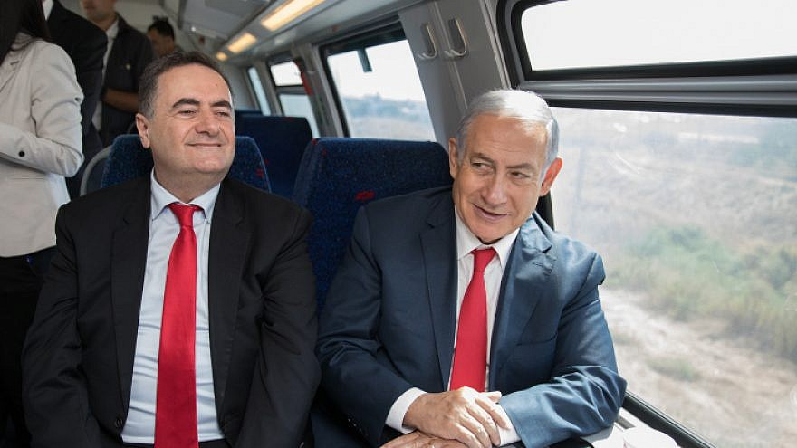 Minister of Transportation Israel Katz (left) and Israeli Prime Minister Benjamin Netanyahu  take a test drive of the Jerusalem-Tel Aviv express train in central Israel on Sept. 20, 2018. Photo by Noam Revkin Fenton/Flash90.