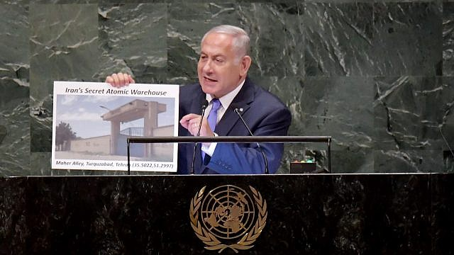 Israeli Prime Minister Benjamin Netanyahu addresses the U.N. General Assembly in New York, visual in hand, revealing a hidden Iranian nuclear facility and secret missiles in Lebanon's capital, on Sept. 27, 2018. Photo by Avi Ohayon/GPO.