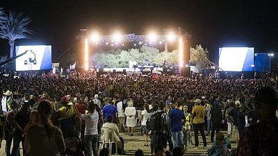 Thousands of Christians gather at Ein Gedi near the Dead Sea for performances and speeches as part of the Feast of Tabernacles festivities. Credit: International Christian Embassy Jerusalem.