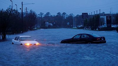 The torrential downpours and storm surges generated by Hurricane Florence have turned roads into rivers and made passage nearly impossible. Credit: Wiki Blog.