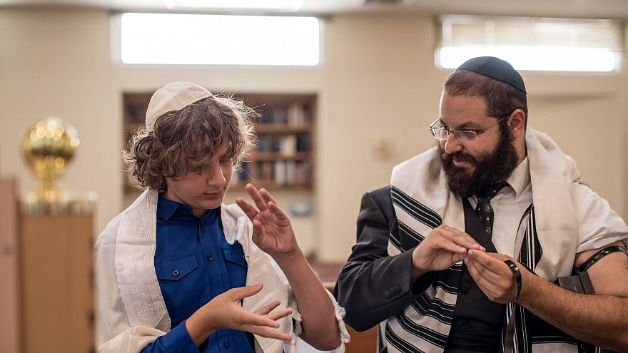Rabbi Yehoshua Soudakoff, executive director of the Jewish Deaf Foundation (JDF) and director of Chabad of the Deaf Community in Israel, working with a student. Courtesy.
